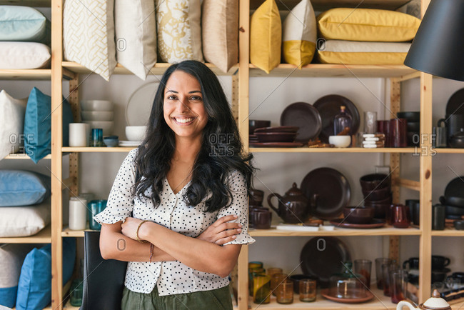 Stylish shopper posing and looking to camera in boutique home store