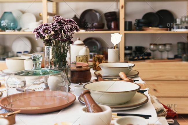 Shallow depth focus on set plate display at artisan craft shop