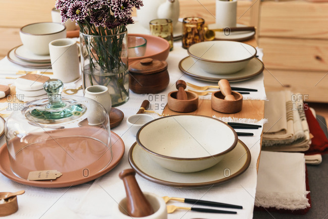 Focus on table set and plates at boutique home goods store