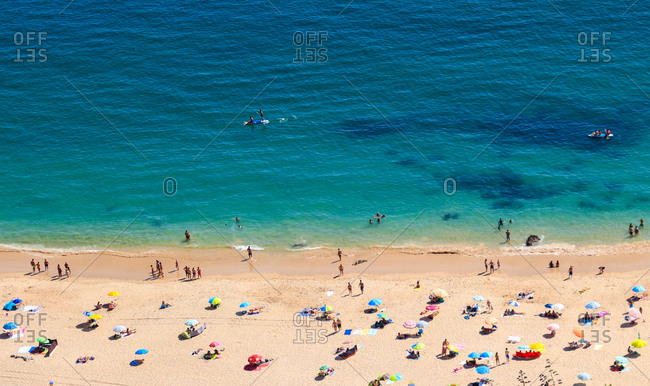 Aerial view from a Tropical beach with colorful umbrellas.