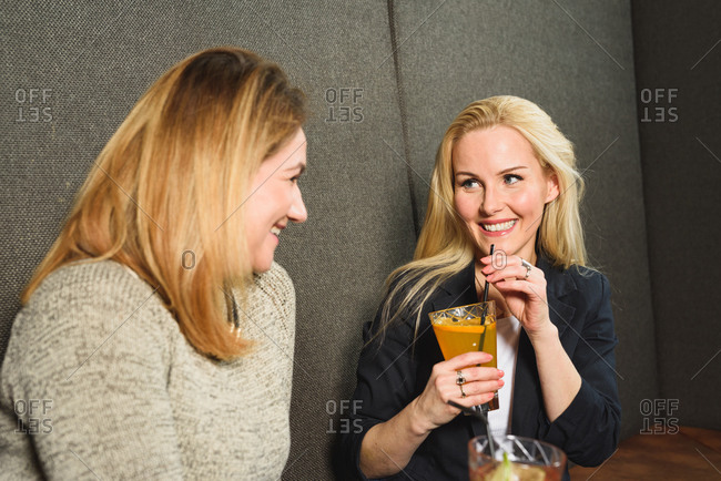 Adult woman resting with friend in bar