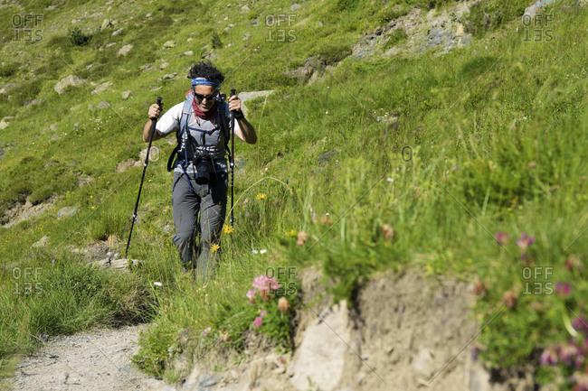 Hiker in Tena Valley, Pyrenees in Spain.