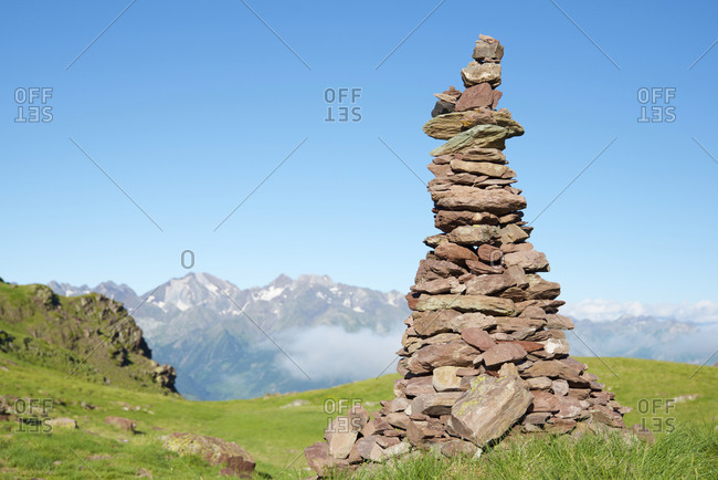 Cairn to indicate the right path in Tena Valley, Huesca province in Aragon, Pyrenees in Spain.