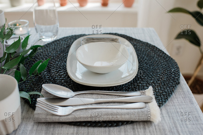 Place setting on a romantic dinner table for two