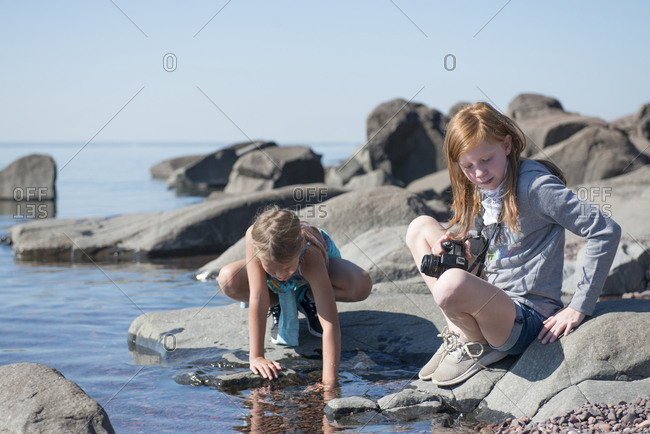 Pre Teen Girls Playing on the Shore