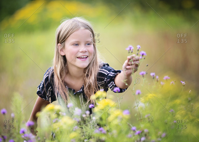 Young Blond Girl in Field of Flowers