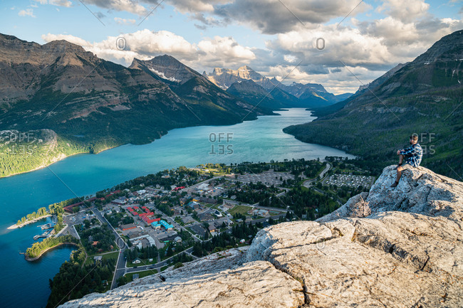 Hiker Watching the Sunset Over Waterton National Park in Alberta
