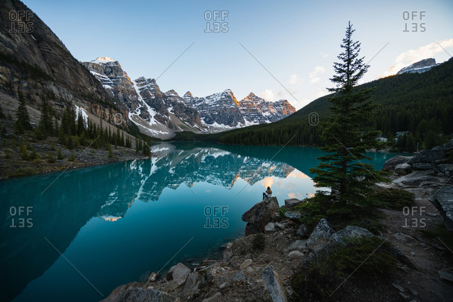 A Hiker Enjoying a Canadian Rockies Sunset at Moraine Lake in Banff