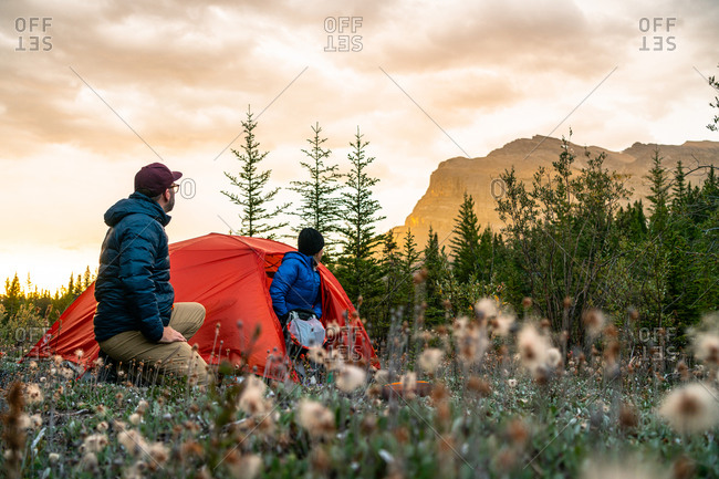 Couple Enjoying Sunrise From Camping Spot Along David Thompson Highway