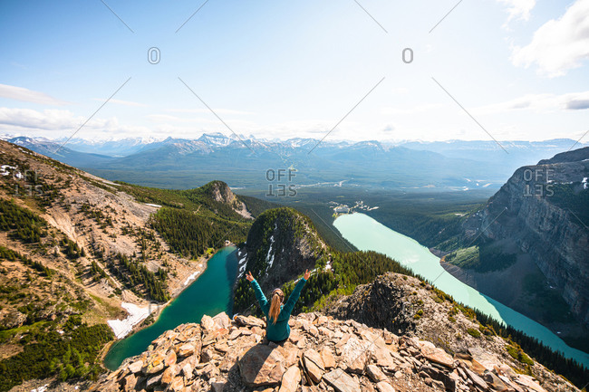 Hiker Celebrating Above Lake Louise and Lake Agnes on Devil's Thumb