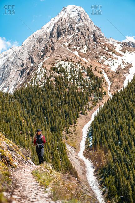 Female Hiker Enjoying Grand Views In Canadian Rockies in Kananaskis