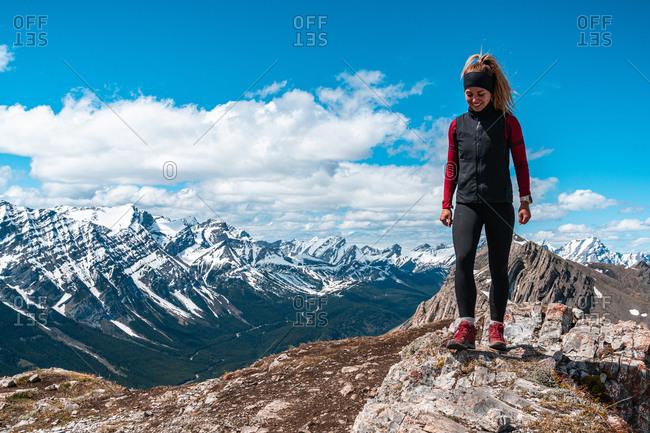 Hiker On Top of Mountain Peak in Canadian Rockies During Spring