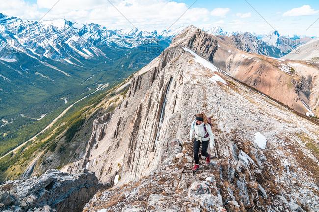 Hiker on Grizzly Peak Summit in Kananaskis Country Canadian Rockies
