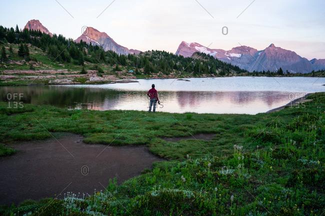 Photographer Watches Sunset at Edge of Limestone Lake