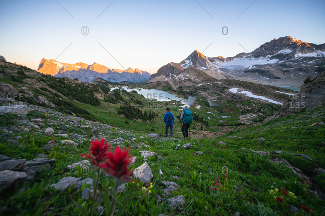 Couple Hiking Together During Sunset in Height of the Rockies