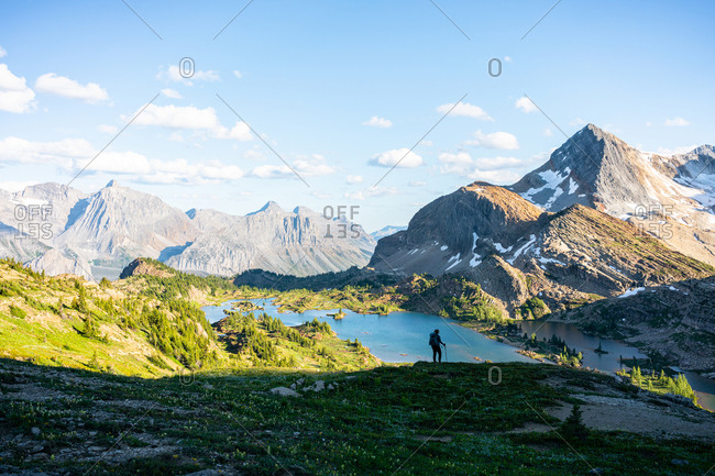 Silhouette of a Hiker During Sunset in Height of the Rockies