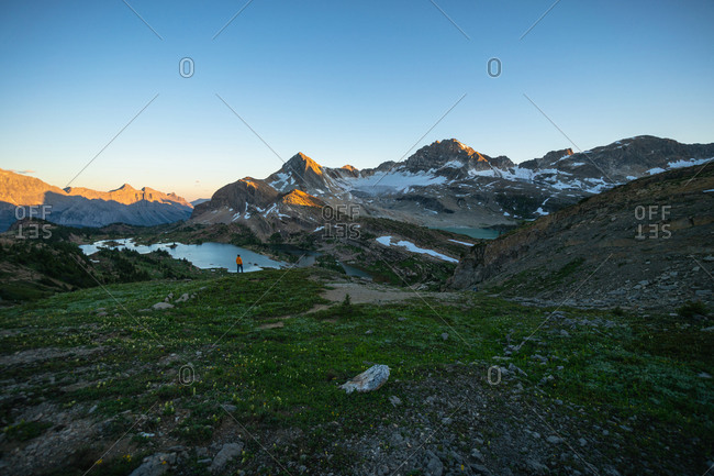 Hiker Watching Sunrise at Limestone Lakes Height of The Rockies