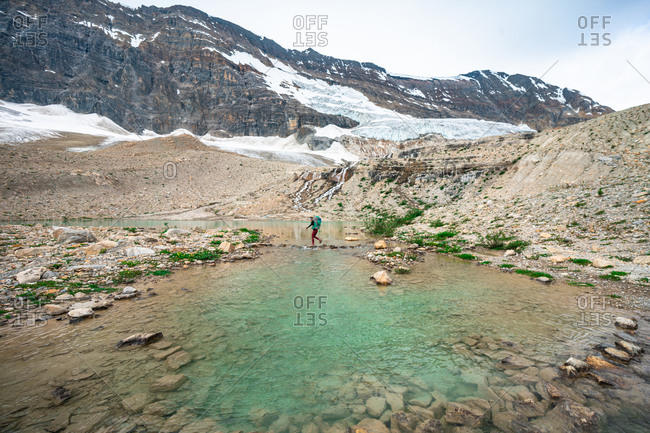 Crossing a Glacial Pond on Iceline Trail in Yoho National Park