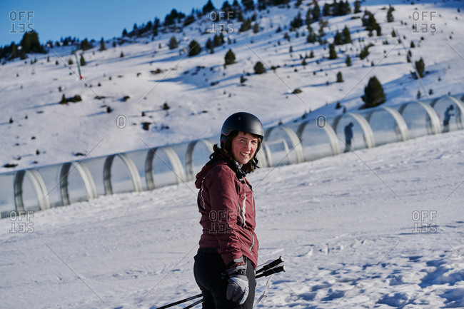 smiling woman climbs the runway in a skier tape