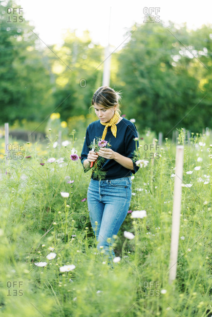 Millennial woman working at her flower farm making bouquets