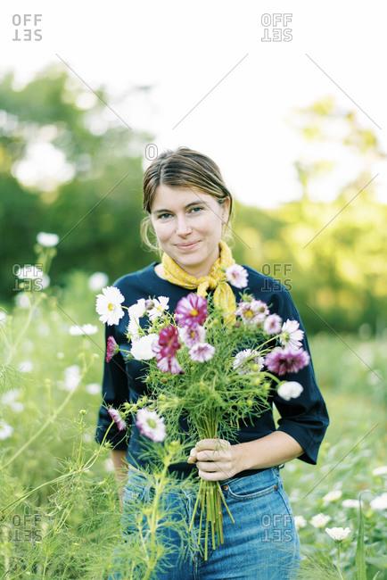 Portrait of a millennial woman working at her flower farm