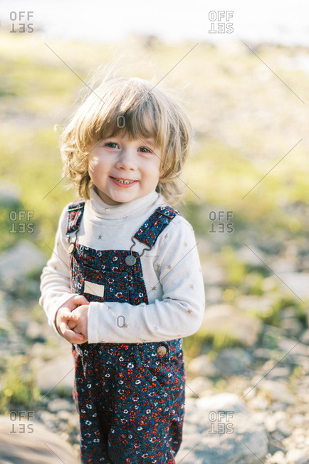 A little toddler girl with a big smile looking into the camera