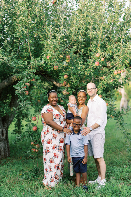 Portrait of a happy family in an apple orchard