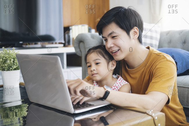 Young man and school-girl working form home and e-learning.