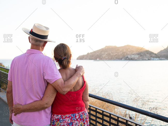 Caucasian elderly couple enjoying the scenery from a harbor lookout point