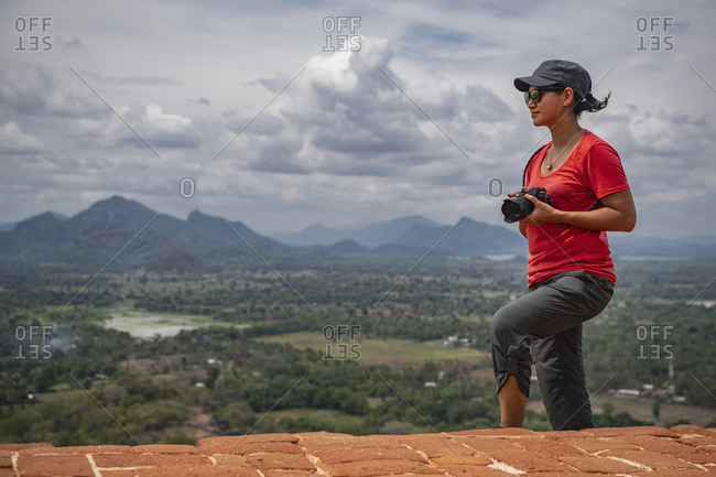 Woman taking picture on the top of the rock fortress of Sigiriya