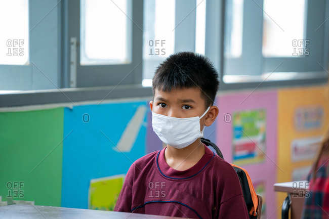 Portrait of an elementary school wearing protective mask