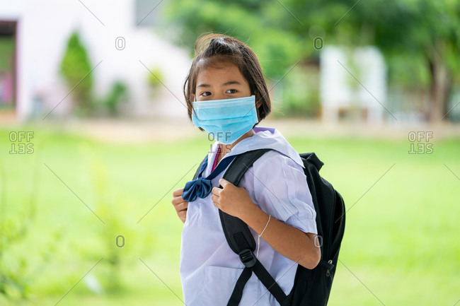 Elementary school students with face mask back at school