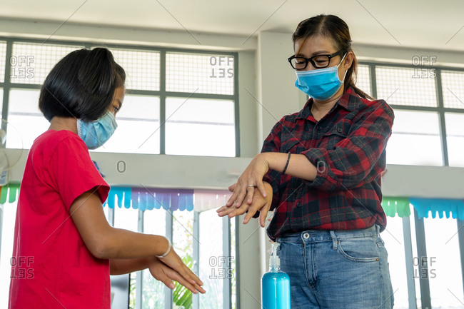 Teacher wearing protective mask to Protect Against Covid-19