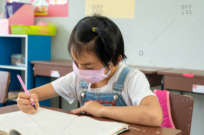 Portrait of an elementary school student wearing protective mask