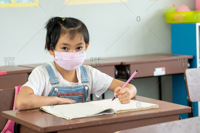 Kids wearing mask protect and safety from corona virus in classroom