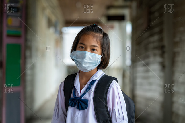 Asian students wearing protective mask to Protect Against Covid-19