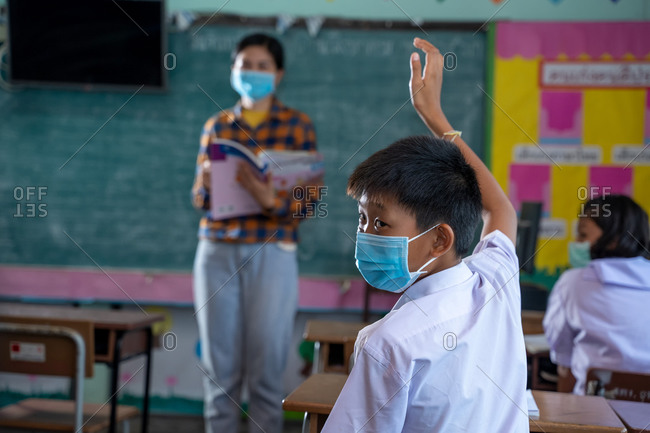 Group of Asian elementary students wearing protective masks