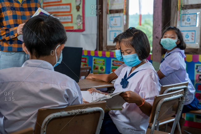 School kids wearing protective mask to Protect Against Covid-19