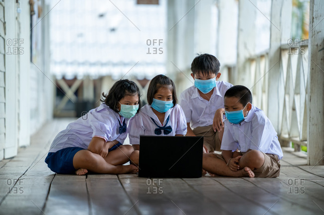 Group of Asian elementary school students wearing hygienic mask