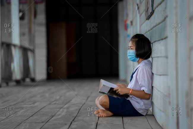 Portrait of Asian children students wearing face masks in school