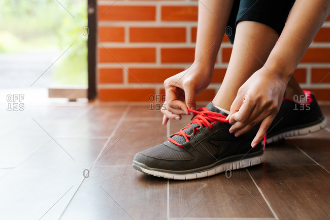 Sport woman tying shoelace before running