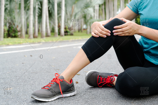 Fitness woman runner feel pain on knee.