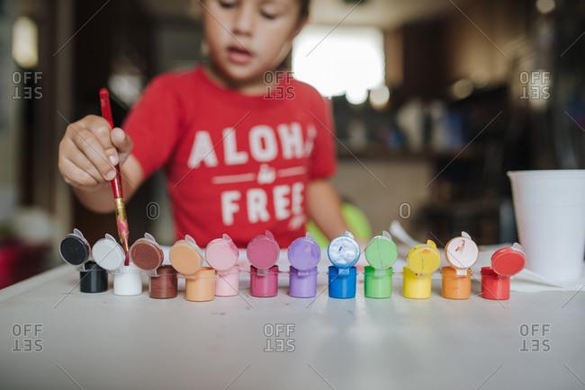 Child Finger Paints at home
