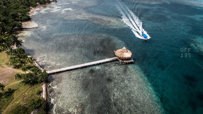 Aerial View Of Speed Boat Driving Past Tropical Island Jetty, Tintipan Island, Colombia