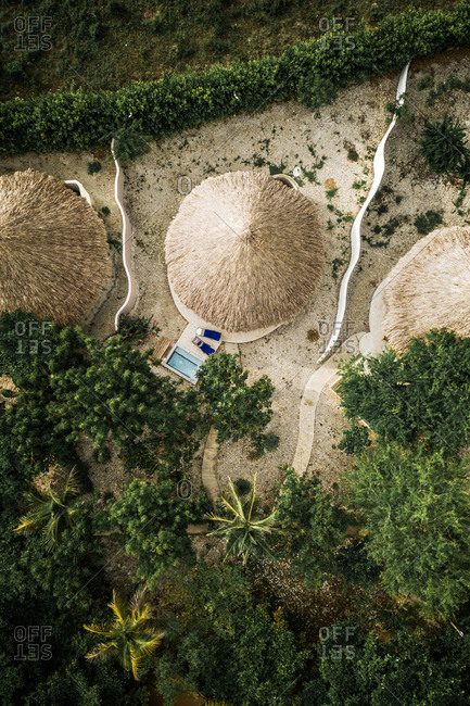 Aerial View Of Luxury Palm Cabana And Private Pool In A Tropical Island Resort Surrounded By Trees, Isla Tierra Bomba, Colombia