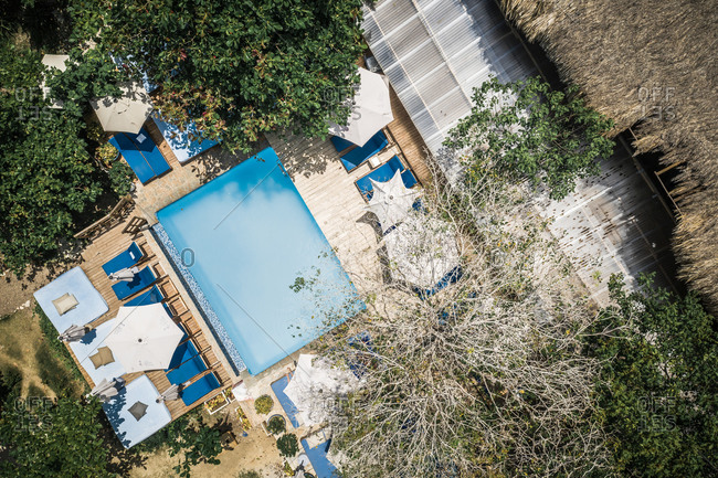 August 5, 2019: Aerial View Of Luxury Island Resort Swimming Pool And Sun Beds, Surrounded By Trees, Caribbean Coast, Colombia