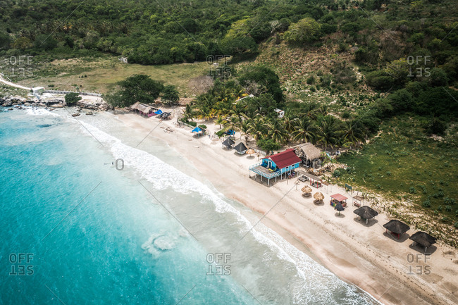 Aerial View Of Blue Beach House And Palm Huts On Tropical Island White Sand Beach, Caribbean Sea, Colombia