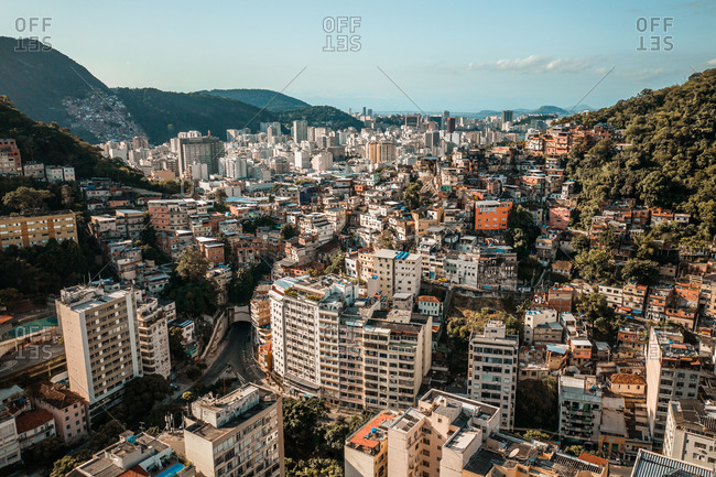 May 4, 2020: Aerial View Of Densely Packed Colored Houses In The Tabajaras Favela And Botafogo Skyline In Rio de Janeiro, Brazil