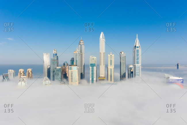 March 14, 2019: Aerial view of misty skyscrapers in Dubai, United Arab Emirates.