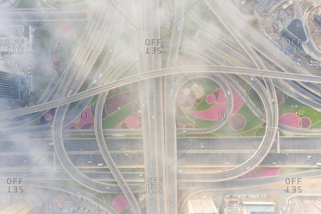 Aerial view of misty interchange in Dubai, United Arab Emirates.